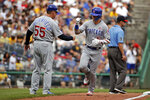 Chicago Cubs' Albert Almora Jr., right, is greeted by third base coach Brian Butterfield (55) as he round third base after hitting a solo home run off Pittsburgh Pirates starting pitcher Jordan Lyles during the second inning of a baseball game in Pittsburgh, Thursday, July 4, 2019. (AP Photo/Gene J. Puskar)