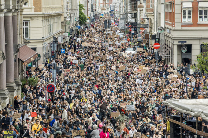 Demonstrators take part in a Black Lives Matter rally protest in Copenhagen, Denmark, Sunday, June 7, 2020, in response to the recent killing of George Floyd by police officers in Minneapolis, USA, that has led to protests in many countries and across the US. (Nikolai Linares/Ritzau Scanpix via AP)