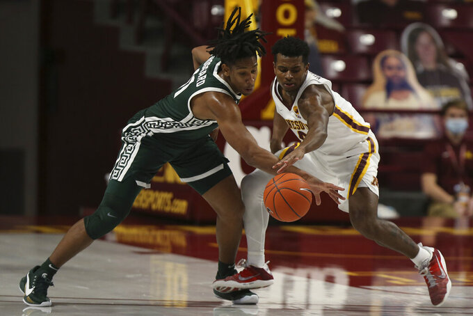 Michigan State's A.J. Hoggard (11) and Minnesota's Jamal Mashburn Jr. (4) go after the ball during the second half of an NCAA college basketball game, Monday, Dec. 28, 2020, in Minneapolis. Minnesota won 81-56. (AP Photo/Stacy Bengs)
