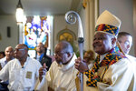 FILE - In this Sunday, June 2, 2019, file photo, Washington D.C. Archbishop Wilton Gregory arrives to applause at St. Augustine Church for Sunday mass in Washington. Pope Francis has named 13 new cardinals, including Washington D.C. Archbishop Wilton Gregory, who would become the first Black U.S. prelate to earn the coveted red cap. In a surprise announcement from his studio window to faithful standing below in St. Peter's Square, Sunday, Oct. 25, 2020, Pope Francis has named 13 new cardinals, including Washington D.C. Archbishop Wilton Gregory, who would become the first Black U.S. prelate to earn the coveted red cap. (AP Photo/Andrew Harnik, File)