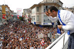Ekrem Imamoglu, candidate of the secular opposition Republican People's Party, or CHP, acknowledges his supporters from atop his campaign bus, during a rally in Istanbul, Friday, June 21, 2019, ahead of June 23 re-run of Istanbul elections. The 49-year-old candidate won the March 31 local elections with a slim majority, but after weeks of recounting requested by the ruling party, Turkey's electoral authority annulled the result of the vote, revoked his mandate and ordered the new election.(AP Photo/Lefteris Pitarakis)