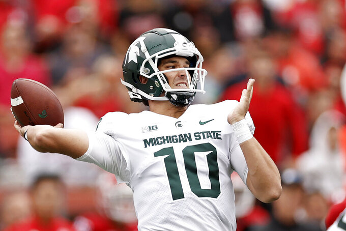 Michigan State quarterback Payton Thorne throws a touchdown pass against Rutgers during the first half of an NCAA college football game Saturday, Oct. 9, 2021, in Piscataway, N.J. (AP Photo/Adam Hunger)
