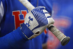 FILE - This March 30, 2019, file photo shows a detail view of an Under Armour batting glove during a Northwestern State University at Houston Baptist University NCAA college baseball game. Under Armour Inc. has threatened Nike, landing major deals with Major League Baseball and star athletes like the NBA's Stephen Curry. But it also faces threats of its own, like the growing popularity of athleisure wear, clothing that can be worn at work and the yoga studio. (AP Photo/Aaron M. Sprecher, File)
