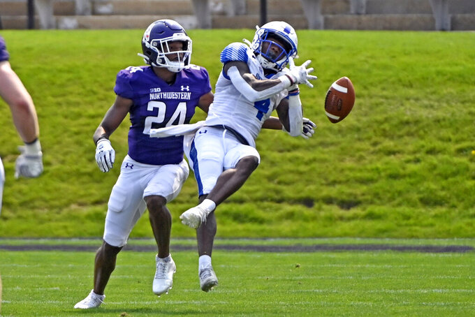 Northwestern defensive back Rod Heard II (24) breaks up a pass intended for Indiana State wide receiver Rontrez Morgan (4) during the second half of an NCAA college football game in Evanston, Ill., Saturday, Sept. 11, 2021. (AP Photo/Matt Marton)