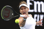 Romania's Simona Halep makes a forehand return to Britain's Harriet Dart during their second round singles match at the Australian Open tennis championship in Melbourne, Australia, Thursday, Jan. 23, 2020. (AP Photo/Dita Alangkara)