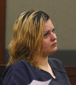 Krystal Whipple, who is charged in the death of nail salon manager Ngoc Q. Nguyen  appears in court during her bail hearing at the Regional Justice Center on Tuesday, July 16, 2019, in Las Vegas. Whipple's attorney is asking a judge to set bail at $100,000 and allow house arrest pending trial on murder, robbery and other felony charges in the death last December of Nguyen. (Bizuayehu Tesfaye /Las Vegas Review-Journal via AP)