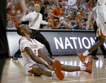 Texas guard Matt Coleman III (2) screams after taking a charge by a Colorado player during an NCAA college basketball game in the quarterfinals of the NIT on Wednesday, March 27, 2019, in Austin, Texas. (Nick Wagner/Austin American-Statesman via AP)