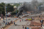 Anti-government protesters burn tires and barricade roads in the capital Bamako, Mali Friday, July 10, 2020. Thousands marched Friday in Mali's capital in anti-government demonstrations urged by an opposition group that rejects the president's promises of reforms. (AP Photo/Baba Ahmed)