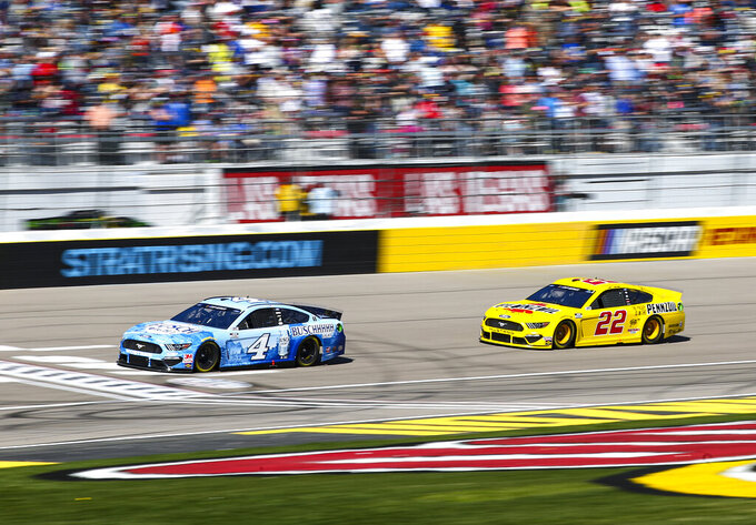 Kevin Harvick (4) and Joey Logano (22) drive during a NASCAR Cup Series auto race at the Las Vegas Motor Speedway on Sunday, Feb. 23, 2020. (AP Photo/Chase Stevens)