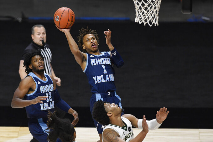 Rhode Island's Fatts Russell shoots as South Florida's David Collins, lower right, defends during the first half of an NCAA college basketball game Saturday, Nov. 28, 2020, in Uncasville, Conn. (AP Photo/Jessica Hill)