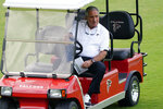 Atlanta Falcons owner Arthur Blank watches during the team's mini camp football practice from a golf cart Tuesday, June 8, 2021, in Flowery Branch, Ga. (AP Photo/John Bazemore)