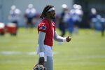 New England Patriots quarterback Cam Newton (1) carries his helmet on the field during an NFL football practice in Foxborough, Mass., Thursday, May 27, 2021. (AP Photo/Steven Senne)