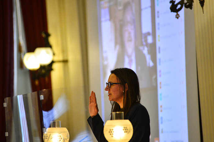 Vermont Secretary of State James Condos administers the oath of office over Zoom to Vermont House Speaker Jill Krowinski, D-Burlington, during the first day of the new session on Wednesday, Jan. 6, 2021  in Montpelier, Vt. 2021.  (Kristopher Radder /The Brattleboro Reformer via AP)