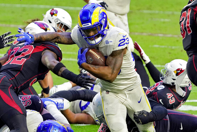 Los Angeles Rams running back Cam Akers (23) runs the ball as Arizona Cardinals strong safety Budda Baker (32) defends during the first half of an NFL football game, Sunday, Dec. 6, 2020, in Glendale, Ariz. (AP Photo/Rick Scuteri)
