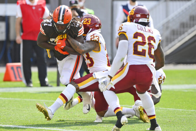 Cleveland Browns running back Kareem Hunt (27) scores on a 9-yard touchdown pass during the first half of an NFL football game against the Washington Football Team, Sunday, Sept. 27, 2020, in Cleveland. (AP Photo/David Richard)