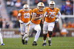 Tennessee quarterback Harrison Bailey (15) scrambles for yards against Florida during the first half of an NCAA college football game Saturday, Dec. 5, 2020, in Knoxville, Tenn. (Randy Sartin/Knoxville News Sentinel via AP, Pool)