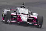 Helio Castroneves, of Brazil, drives through the first turn during qualifications for the Indianapolis 500 auto race at Indianapolis Motor Speedway in Indianapolis, Saturday, May 22, 2021. (AP Photo/Michael Conroy)