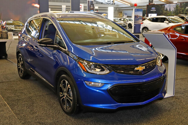 FILE - In this Feb. 13, 2020 file photo a 2020 Chevrolet Bolt EV is displayed at the 2020 Pittsburgh International Auto Show in Pittsburgh. The U.S. government's road safety agency is investigating complaints that the Chevrolet Bolt electric vehicle can catch fire. The probe by the National Highway Traffic Safety Administration covers nearly 78,000 Bolts made by General Motors from the 2017 through 2020 model years. (AP Photo/Gene J. Puskar, File)