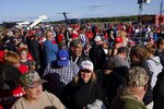 Supporters arrive for a campaign rally with President Donald Trump at the Central Wisconsin Airport Thursday, Sept. 17, 2020, in Mosinee, Wis. (AP Photo/Morry Gash)