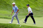 Collin Morikawa, left, and Justin Thomas walk up the 18th green during the third round of the Workday Charity Open golf tournament, Saturday, July 11, 2020, in Dublin, Ohio. (AP Photo/Darron Cummings)