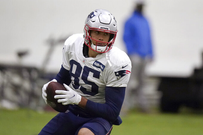 New England Patriots tight end Hunter Henry runs with the ball during an NFL football practice, Wednesday, Oct. 27, 2021, in Foxborough, Mass. (AP Photo/Steven Senne)