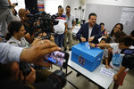 Israeli Arab politician Ayman Odeh casts his vote in Haifa, Israel, Tuesday, Sept. 17, 2019. Israelis began voting Tuesday in an unprecedented repeat election that will decide whether longtime Prime Minister Benjamin Netanyahu stays in power despite a looming indictment on corruption charges. (AP Photo/Ariel Schalit)