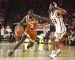 Texas guard Courtney Ramey (3) pushes past Oklahoma guard Jamal Bieniemy (24) during the first half of an NCAA college basketball game in Norman, Okla., Tuesday, March 3, 2020. (Kyle Phillips/The Norman Transcript via AP)