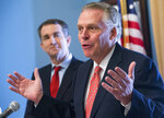 FILE - In this Jan. 9, 2018, file photo, former Virginia Gov. Terry McAuliffe, right, speaks to the media along with Gov. Ralph Northam at the Capitol in Richmond, Va. Northam announced Thursday, April 8, 2021, that he was backing McAuliffe in the race to succeed him, handing his predecessor one of the contest's most coveted endorsements. (AP Photo/Steve Helber, File)