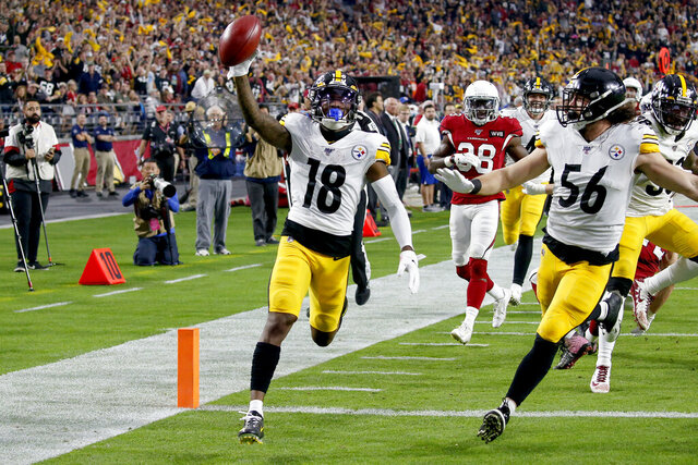Pittsburgh Steelers wide receiver Diontae Johnson (18) runs in an 85-yard punt return for a touchdown against the Arizona Cardinals during the first half of an NFL football game, Sunday, Dec. 8, 2019, in Glendale, Ariz. (AP Photo/Ross D. Franklin)