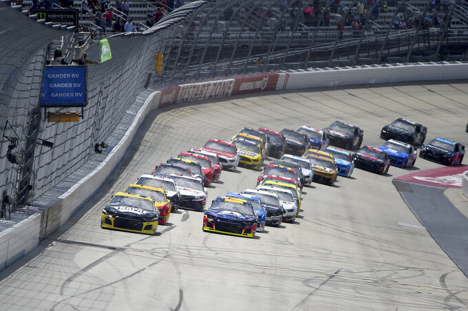 Driver Chase Elliott (9), left, leads as drivers take the green flag during the NASCAR Cup Series auto race, Monday, May 6, 2019, at Dover International Speedway in Dover, Del. (AP Photo/Will Newton)