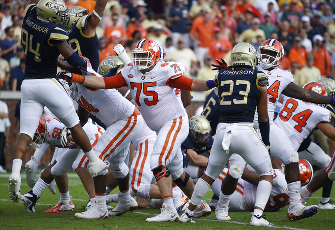 FILE - In this Sept. 22, 2018, file photo, Clemson offensive tackle Mitch Hyatt (75) works against Georgia Tech during the first half of an NCAA college football game, in Atlanta. Hyatt passed up a chance to be a high NFL draft pick last year and has put together an excellent senior season. (AP Photo/Jon Barash, mFile)