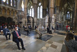 Attendees socially distance during a service to mark the 80th anniversary of the Battle of Britain at Westminster Abbey, London, Sunday, Sept. 20, 2020. (Aaron Chown/Pool Photo via AP)