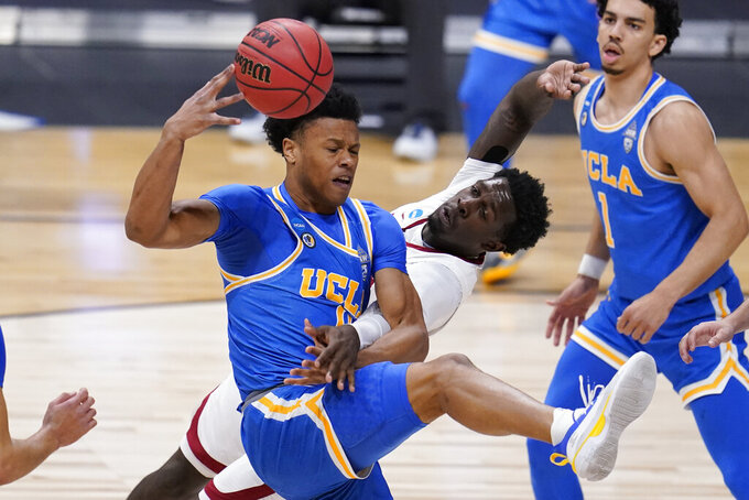 UCLA guard Jaylen Clark (0) and Alabama forward Juwan Gary (4) collide in the first half of a Sweet 16 game in the NCAA men's college basketball tournament at Hinkle Fieldhouse in Indianapolis, Sunday, March 28, 2021. (AP Photo/Michael Conroy)