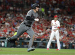 Arizona Diamondbacks' Jake Lamb, left, rounds the bases after hitting a solo home run off St. Louis Cardinals relief pitcher Andrew Miller during the seventh inning of a baseball game Friday, July 12, 2019, in St. Louis. (AP Photo/Jeff Roberson)
