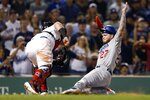 Boston Red Sox's Christian Vazquez tags out Los Angeles Dodgers' Alex Verdugo (27) at home plate during the 11th inning of a baseball game in Boston, Sunday, July 14, 2019. (AP Photo/Michael Dwyer)