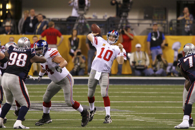 CORRECTS DATE TO FEB. 5, 2012- File- This Feb. 5, 2012, file photo shows New York Giants quarterback Eli Manning,  in action against the New England Patriots at Super Bowl XLVI  in Indianapolis, Ind. The man who has been the face of the New York Giants since 2004 is probably going to make his final appearance this weekend. Manning's 16-year Giants' career that has included two Super Bowl titles likely will come to an end Sunday, Dec. 29, 2019, when New York tries to spoil the Philadelphia Eagles bid to win the NFC East. (AP Photo/Gregory Payan, File)
