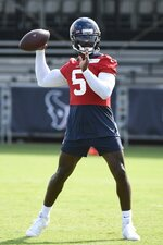 Texans quarterback Tyrod Taylor (5) throws the ball during NFL football practice Thursday, July 29, 2021, in Houston. (AP Photo/Justin Rex)