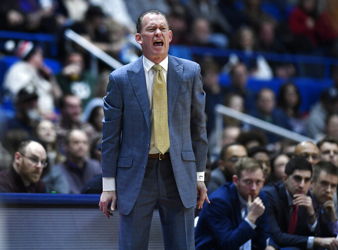 East Carolina head coach Joe Dooley calls to his team during the second half of an NCAA college basketball game against Connecticut, Sunday, Feb. 3, 2019, in Hartford, Conn. (AP Photo/Jessica Hill)