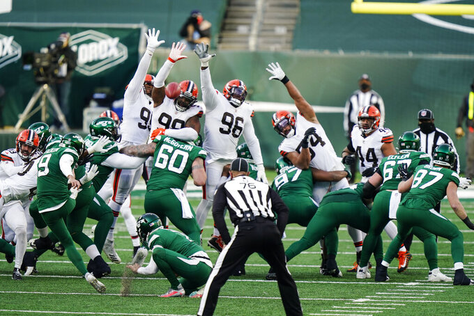 The Cleveland Browns block a field goal by New York Jets kicker Sam Ficken (9) during the second half of an NFL football game Sunday, Dec. 27, 2020, in East Rutherford, N.J. (AP Photo/Corey Sipkin)