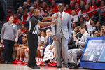 Dayton head coach Anthony Grant, right, reacts to a foul call during the first half of an NCAA college basketball game against North Texas, Tuesday, Dec. 17, 2019, in Dayton, Ohio. (AP Photo/John Minchillo)