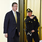 FILE - In this Feb. 2, 2016, file photo, former Montgomery County District Attorney Bruce Castor is directed to another elevator after taking the witness stand in a pretrial hearing for comedian Bill Cosby and his sexual assault case, as he leaves Montgomery County Courtroom A in Norristown, Pa. Cosby was convicted of sexual assault in 2018. He is serving up to 10 years in prison. Now in the midst of another historic reckoning, this time addressing the treatment of African Americans and other people of color by police and the criminal justice system, the 82-year-old Cosby has won the right to an appeal. (Clem Murray/The Philadelphia Inquirer via AP, Pool, File)