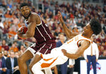 Texas A&M forward Josh Nebo (32) drives inside and collides with Texas guard Jase Febres (13) during the first half of an NCAA college basketball game, Sunday, Dec. 8, 2019, in Fort Worth, Texas. (AP Photo/Ron Jenkins)