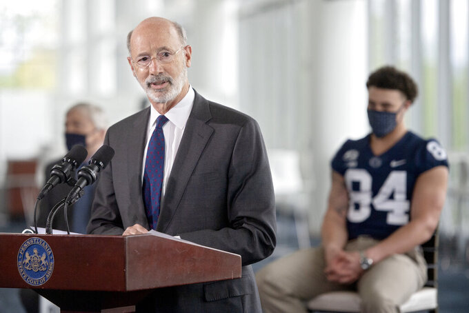 Pennsylvania Gov. Tom Wolf speaks about the importance of Pennsylvanians getting the coronavirus vaccine during a visit to Penn State's Pegula Ice Arena, Wednesday, May 5, 2021, in State College, Pa. (Abby Drey/Centre Daily Times via AP)