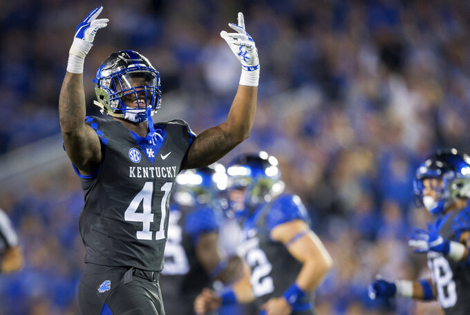 FILE - In this Sept. 29, 2018, file photo, Kentucky linebacker Josh Allen (41) rallies fans during the second half of the team's game against South Carolina, in Lexington, Ky. Allen was named to the 2018 AP All-America NCAA college football team, Monday, Dec. 10, 2018.(AP Photo/Bryan Woolston, File)