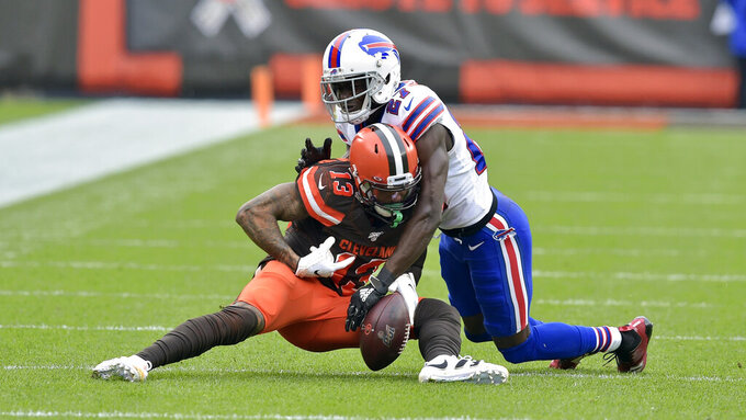 Cleveland Browns wide receiver Odell Beckham Jr. (13) cannot hold onto the ball under pressure from Buffalo Bills cornerback Tre'Davious White (27) during the first half of an NFL football game, Sunday, Nov. 10, 2019, in Cleveland. (AP Photo/David Richard)
