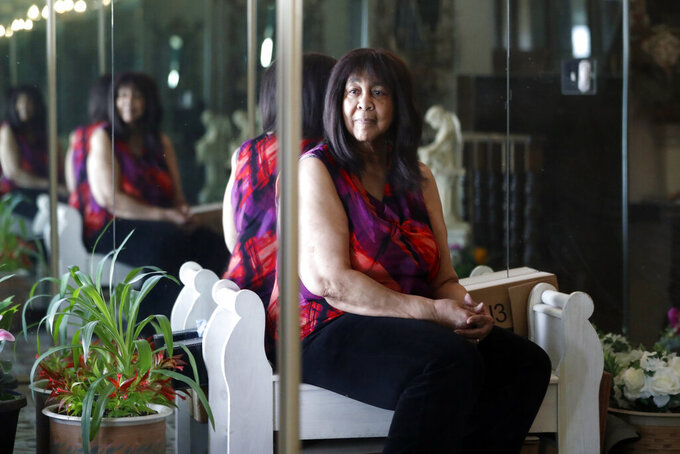 Lifelong Evanston resident and reparations applicant Teri Murray poses for a portrait in her home in Evanston, Ill., Friday, April 23, 2021. Murray tried to buy her first home in 1968, but banks rejected her, offering dubious excuses that they had stopped offering loans or the application period had closed. Now her community is trying to make amends as the first American city to pay reparations. (AP Photo/Shafkat Anowar)