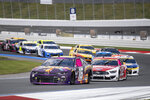 AJ Allmendinger (16) leads a pack of cars during a NASCAR Cup Series auto racing race at Charlotte Motor Speedway, Sunday, Oct. 10, 2021, in Concord, N.C. (AP Photo/Matt Kelley)