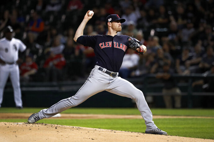 Cleveland Indians starting pitcher Shane Bieber delivers during the first inning of the team's baseball game against the Chicago White Sox on Wednesday, Sept. 25, 2019, in Chicago. (AP Photo/Charles Rex Arbogast)