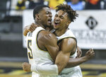Wichita State's Trey Wade, left, and Tyson Etienne celebrate after the team's win over Houston in an NCAA college basketball game Thursday, Feb. 18, 2021, in Wichita, Kan. (Travis Heying/The Wichita Eagle via AP)