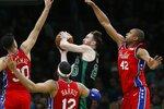 Philadelphia 76ers' Furkan Korkmaz (30), Tobias Harris (12) and Al Horford (42) defend against Boston Celtics' Gordon Hayward (20) during the second half of an NBA basketball game in Boston, Saturday, Feb. 1, 2020. (AP Photo/Michael Dwyer)